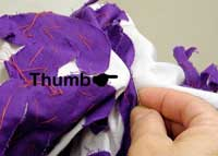 Thumb placement from the top when appliqueing on a large quilt